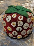 Pincushion with pearl buttons.