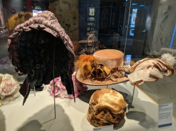 "Left: Winter ""pumpkin"" bonnet, c. 1840-1850. Middle front: Cloche hat, c 1920s. Middle rear: Woman's hat, c 1905-1910. Right: Wedding bonnet, c1890, worn by Mary Booth who married George Challacombe on December 17, 1890."
